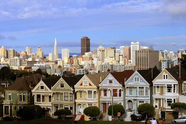 The Painted Ladies in San Francisco, a row of tri-colored Victorian houses with the San Francisco skyline in the background.